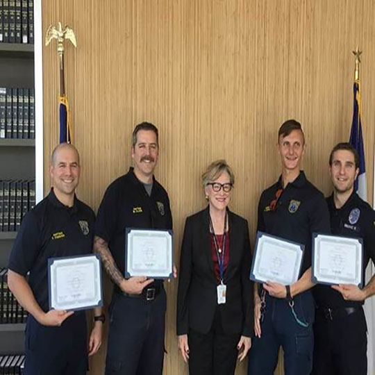 DA Margaret Moore awarding members of the EMS Tactical Response Team for their service and for their participation in an office wide training on active shooter situations