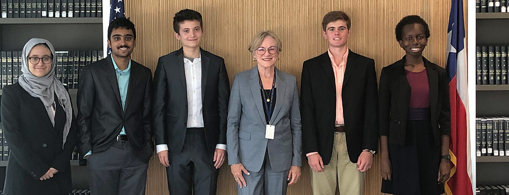 2019 High School Summer Interns with TCDA Margaret Moore following their mock trial presentation. Five area high schools were represented: Austin High School, Ann Richards School, John B. Connally High School, Austin Peace Academy, and Westwood High School.