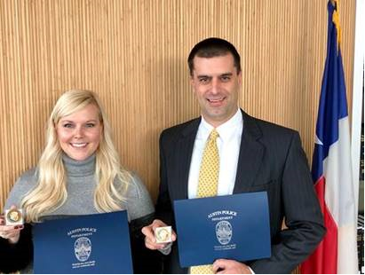 VCSP prosecutors Allison Tisdale and Matt Foye receiving citations and Commander's Coins from APD Highway Enforcement Command for their work with vehicular crimes.
