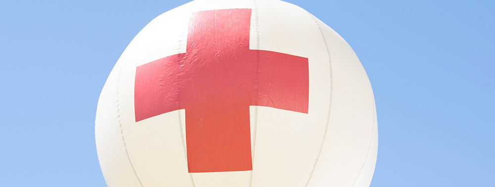 red medical cross symbol on balloon