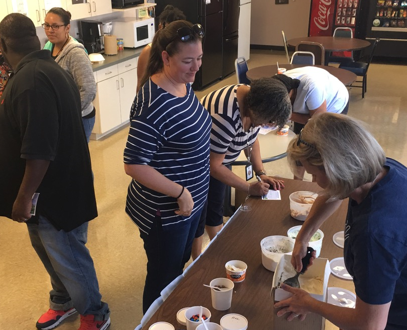 case worker in ice cream social getting ice cream