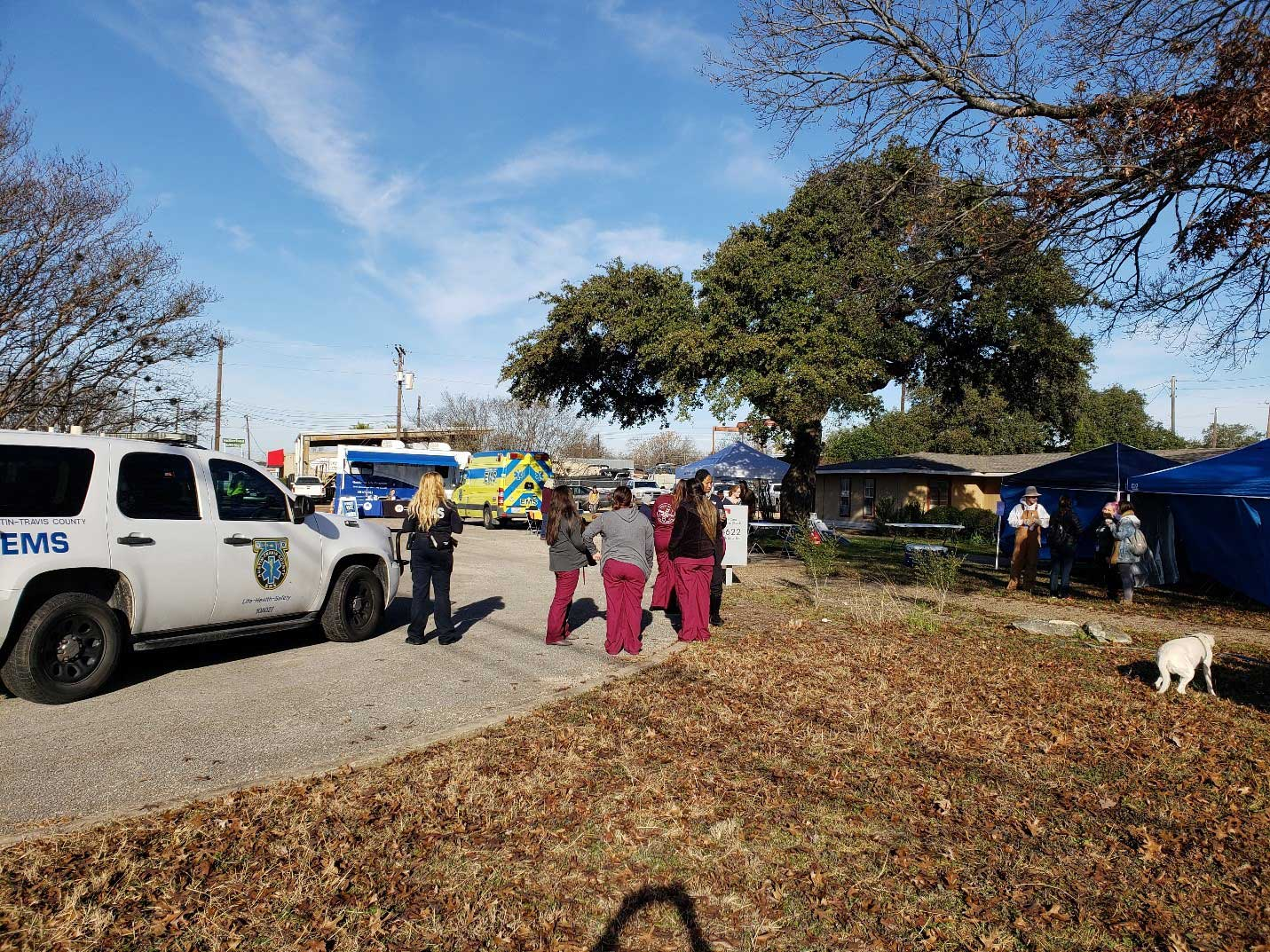 pop-up clinic: EMS vehicles and staff, pop-up clinic tents on background