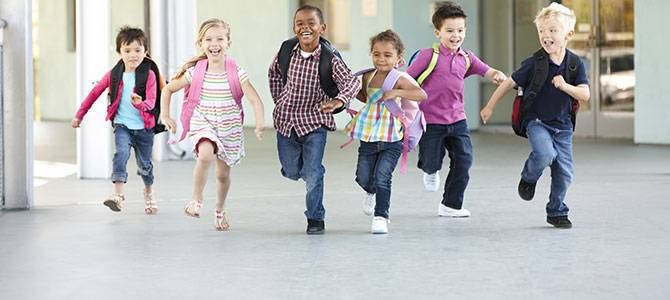 kids running with backpacks